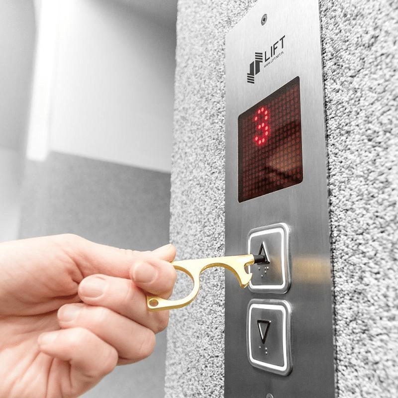 Hygienisk knapptryckare Nyckelring Guld